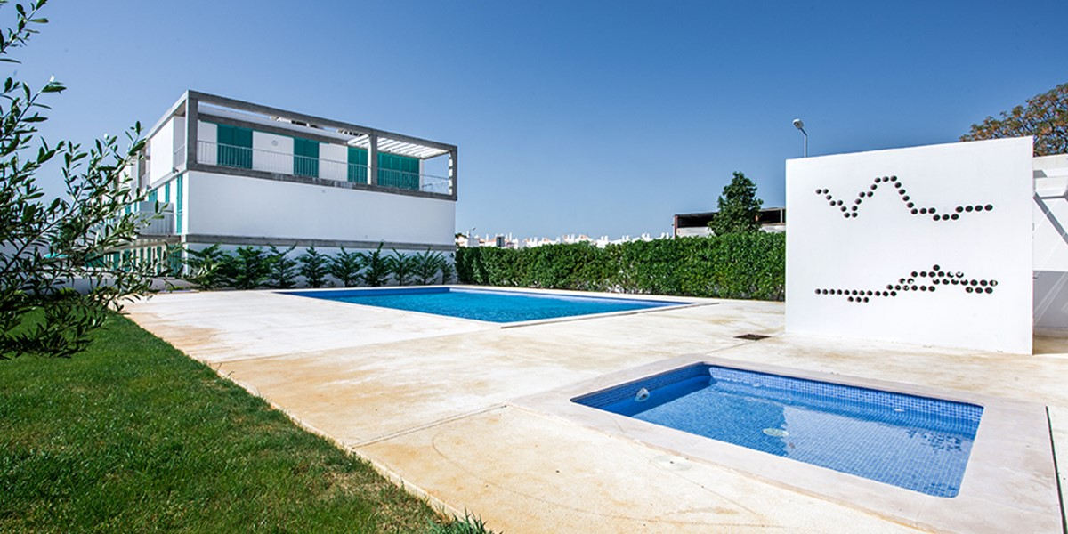 The building over looking the swimming pool